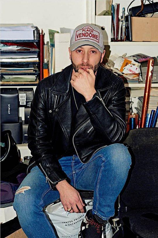 Biker style black leather jacket.
